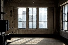 Industrial interior with br light. From the windows Stock Images