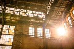 Industrial interior with br light. From the windows Royalty Free Stock Photo