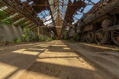 Industrial interior with bright light. Abandoned industrial interior with bright light angle Stock Photography