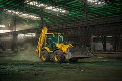 Industrial interior with bulldozer inside Stock Photos