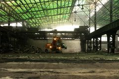 Industrial interior with bulldozer inside Royalty Free Stock Images