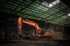 Industrial interior with bulldozer inside Stock Photos