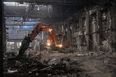 Industrial interior with bulldozer inside Stock Images