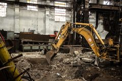 Industrial interior with bulldozer inside Royalty Free Stock Photography