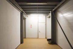 Industrial interior. Empty factory corridor with closed door. Industrial interior. Empty factory corridor with closed grey door royalty free stock photo