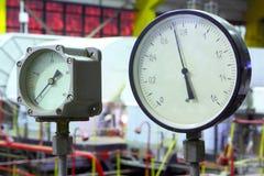Industrial interior and equipment. Manometers. Stock Photos
