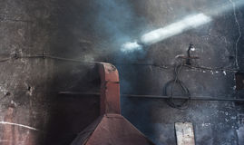 Industrial Interior. Factory interior with light coming in. Foundry Stock Photos