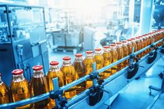 Free Industrial Interior Of Natural Juice Plant Production In Blue Color. Conveyor Belt, Filled Bottles On Beverage Factory Royalty Free Stock Photo - 169125605