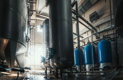 Free Industrial Interior Of Water Factory Production. Large Steel Tanks For Filtering And Potable Water Treatment. Industry Stock Image - 184512281