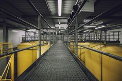 Industrial interior with welded silos Royalty Free Stock Images