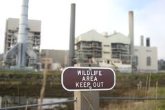 Industrial Irony #4. A wildlife area contains a large industrial plant Royalty Free Stock Photo