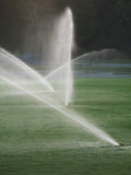 Industrial Irrigation. Irrigation equipment watering a golf course or soccer field Royalty Free Stock Photography