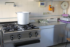 Industrial kitchen with gas stove and the giant aluminum pot Royalty Free Stock Photos