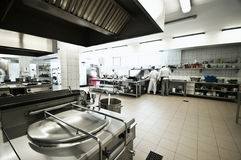 Industrial kitchen. Of a restaurant, hotel or hospital with busy cooks working royalty free stock image