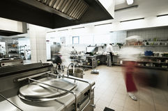 Industrial kitchen. Of a restaurant, hotel or hospital with busy cooks working Stock Photo