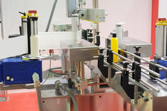 Industrial labeling equipment Stock Image