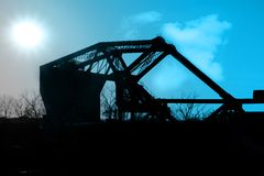 Industrial Landscape. Dramatic sunset behind massive industrial bridge royalty free stock photos