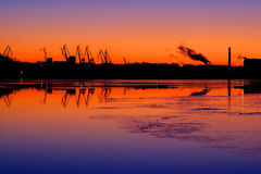 Industrial landscape. Sunset above the river. In the background industrial landscape stock photo