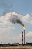 Industrial landscape with a burning torch. In Kazan Stock Images