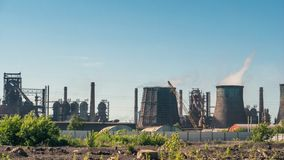 Industrial landscape, chimneys with smoke of power plant or factory, heavy industry. Toned royalty free stock photography