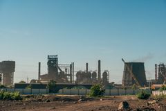 Industrial landscape, chimneys with smoke of power plant or factory. Toned royalty free stock image