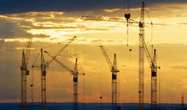 Industrial landscape with construction cranes Stock Photos
