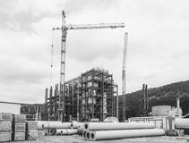 Industrial landscape construction site of the gypsum processing plant. Black and white photo royalty free stock images