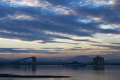 Industrial landscape at dusk Stock Photos