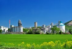 Industrial landscape factory buildings. Industrial landscape with cement works factory buildings producing cement and concrete, industrialization of the royalty free stock photography