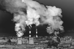 Industrial landscape with factory pipe polluting air, smoke from chimneys. Stock Photography