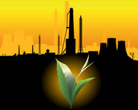 Industrial Landscape. Green sprout with a black silhouette of industrial buildings on an orange background Stock Photo