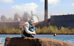 Industrial landscape with little boy
