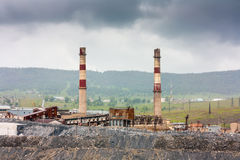 Industrial landscape magnesite plant in a cloudy day. Industrial landscape magnesite plant in a summer royalty free stock photos