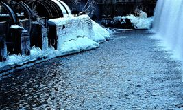 Cold and icy at the stream. Industrial landscape in Norrköping is beautiful in winter, ice and cold give atmosphere Stock Photo