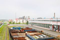 Industrial landscape. Panoramic view of technological pipes. Rusty pipes, blue rubies, production communications. Repair buildings royalty free stock image