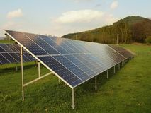 Industrial landscape with photovoltaic power plant on meadow Stock Photo