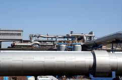 Industrial landscape - pipe. Industrial facilities in the sun Stock Photography
