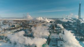 Industrial landscape. From pipe factory smoke, polluting the atmosphere. White smoke from the chimney on blue sky background. Ecology environment industry stock video