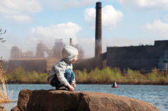 Industrial landscape with playing boy Stock Photos
