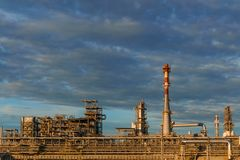 Industrial landscape - refinery. Industrial landscape - oil refinery with pipelines, distillers and chimneys royalty free stock images