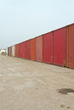 Industrial landscape of row of red containers. Blue cloudy sky. Royalty Free Stock Photography