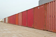 Industrial landscape of row of red containers. Blue cloudy sky. Royalty Free Stock Images