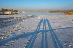 Industrial landscape. Shadows of people on the shore of lake. Shadows of people on the shore of lake during sunset. Industrial landscape Royalty Free Stock Photo