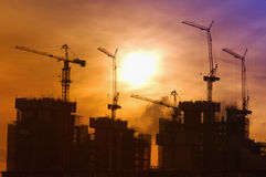 Industrial landscape with silhouettes of cranes Stock Photography