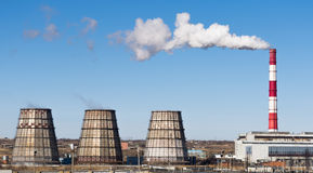 Industrial landscape. Thermal power plant with smoking chimneys. Horizontal rectangular photo Royalty Free Stock Photography