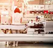 Industrial landscape with a worker behind a machine tool, which makes part of wiring for cars at a modern plant in a production stock photography