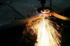 Industrial Laser cutting metal with sparks Stock Photography