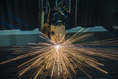 Industrial Laser cutting processing manufacture technology of flat sheet metal steel material with sparks. Laser cut metal splashes Royalty Free Stock Photos