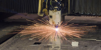 Industrial Laser cutting processing manufacture technology of flat sheet metal steel material with sparks Stock Image