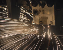 Industrial Laser cutting processing manufacture technology of flat sheet metal steel material with sparks. Laser cut metal splashes Stock Photography